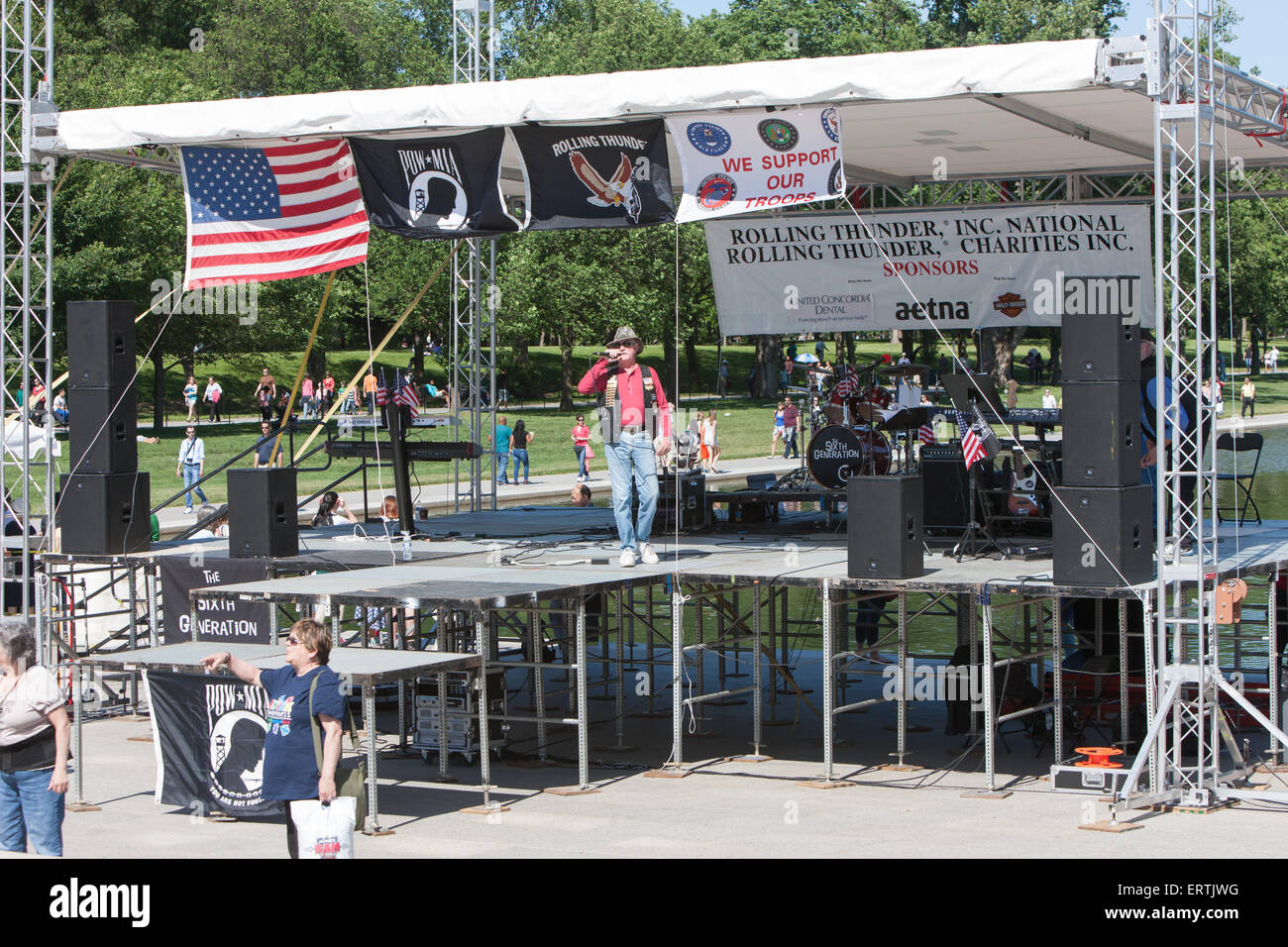 A speaker talks to the crowd prior to the Rolling Thunder Ride for Freedom honoring veterans, POWs, and MIAs at - Stock Image