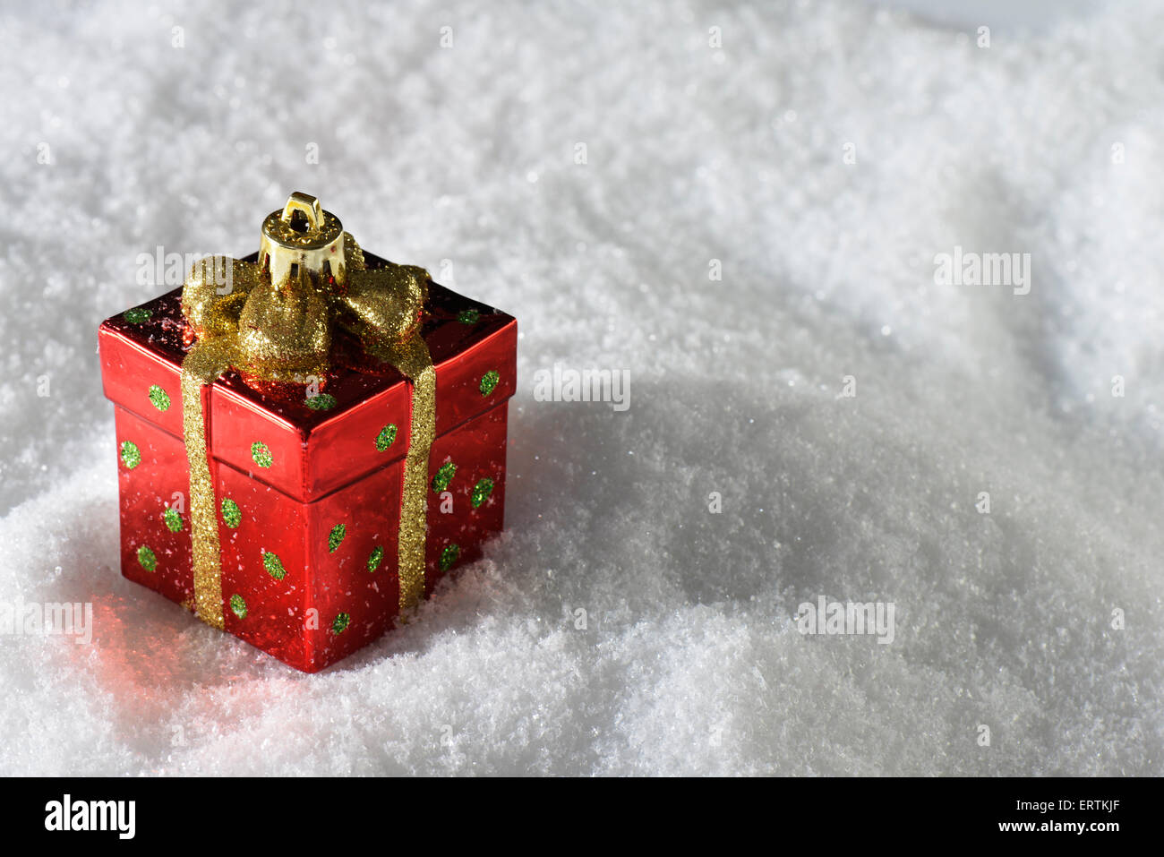 Christmas decoration bundle present gift on snow - Stock Image