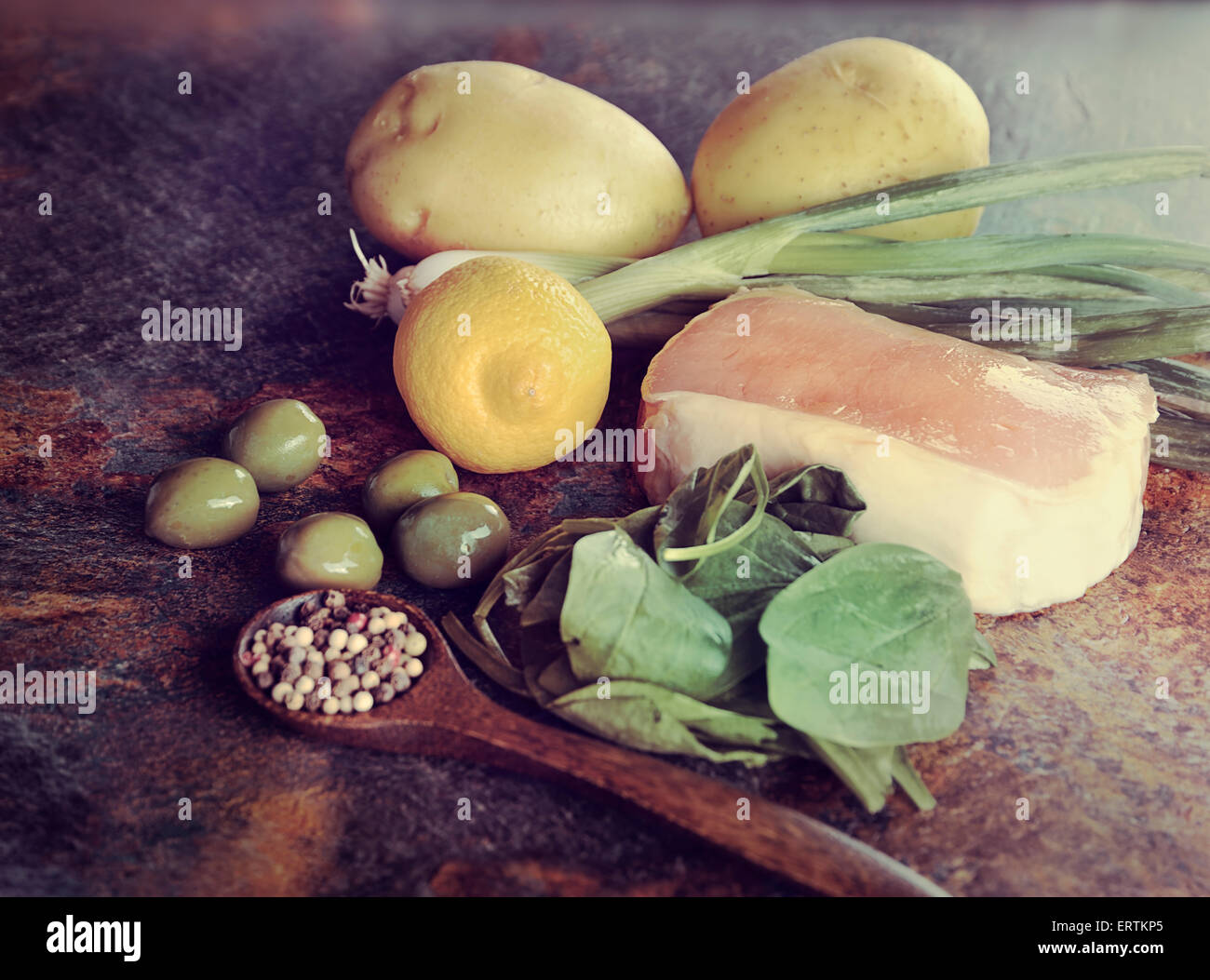 Pork Roast with Gold Potatoes and Spinach - Stock Image