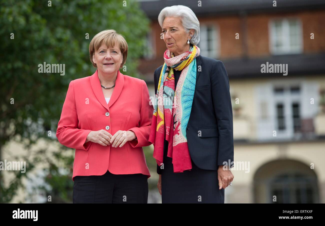 German Chancellor Angela Merkel welcomes IMF President Christine