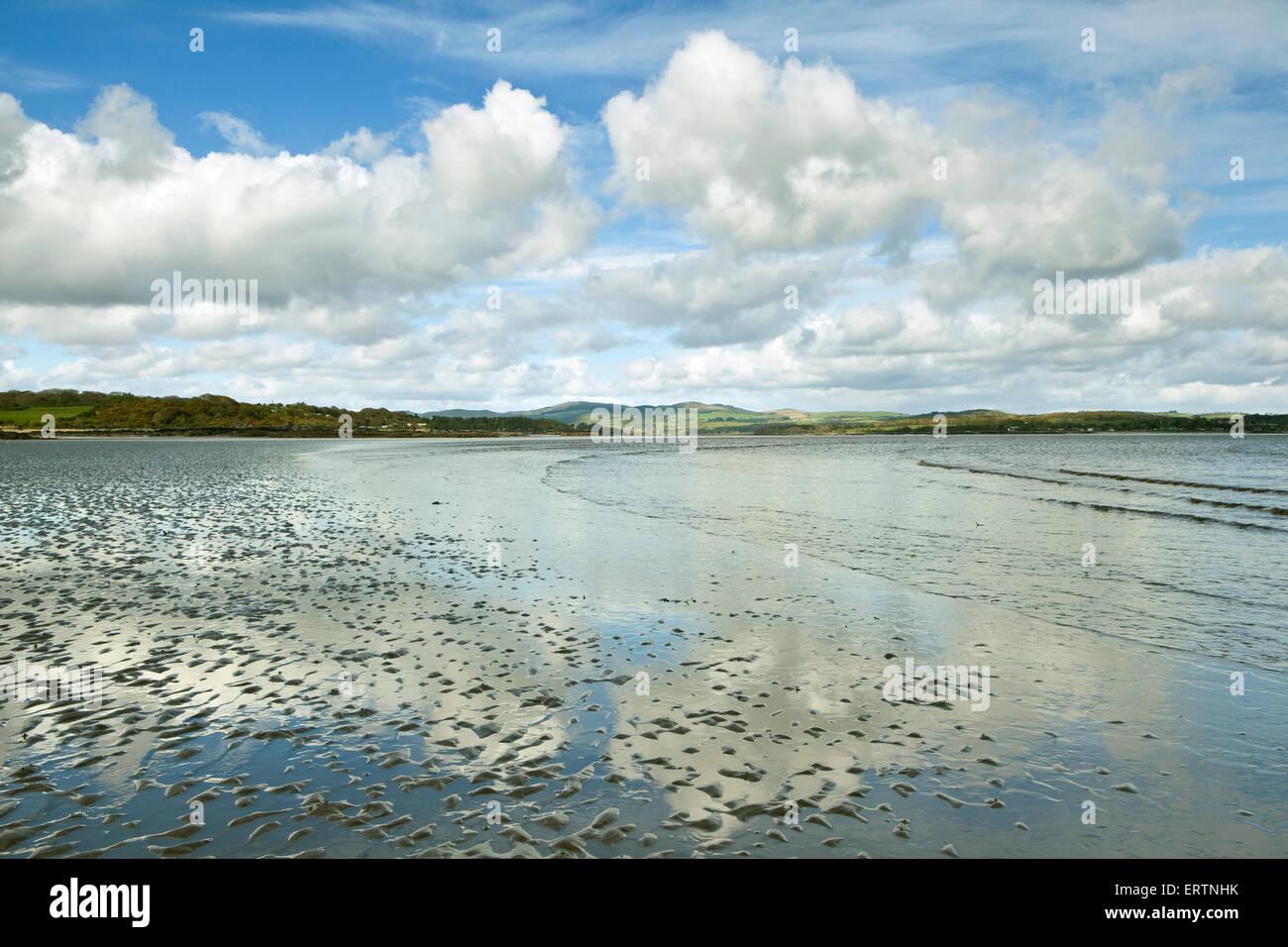 Fair weather cloud over the beach at Mossyard on Fleet Bay near Gatehouse of Fleet, Dumfries and Galloway, Scotland - Stock Image