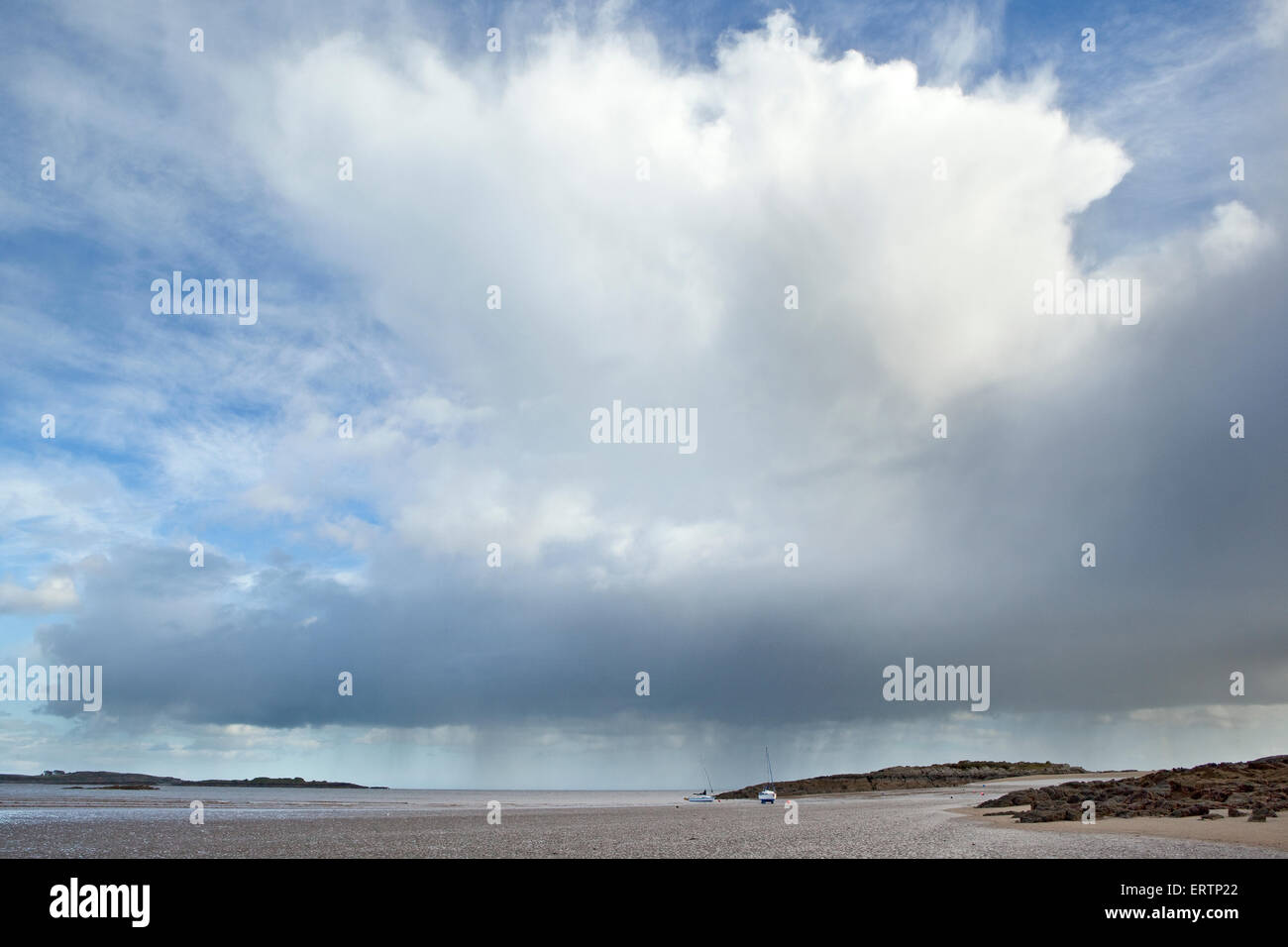A shower cloud over the beach at Mossyard on Fleet Bay near Gatehouse of Fleet, Dumfries and Galloway, Scotland - Stock Image