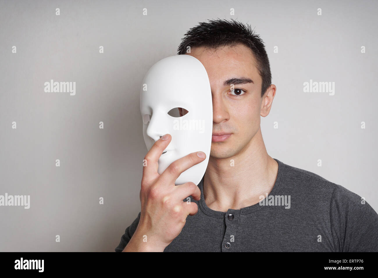 young man with mask - Stock Image