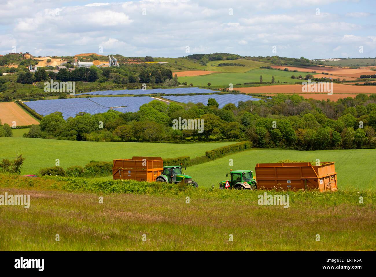 Solar Farm, panels, quarry, fields, farm, tractors, trailers, silage, biofuel Blackwater, Isle of Wight, England, - Stock Image