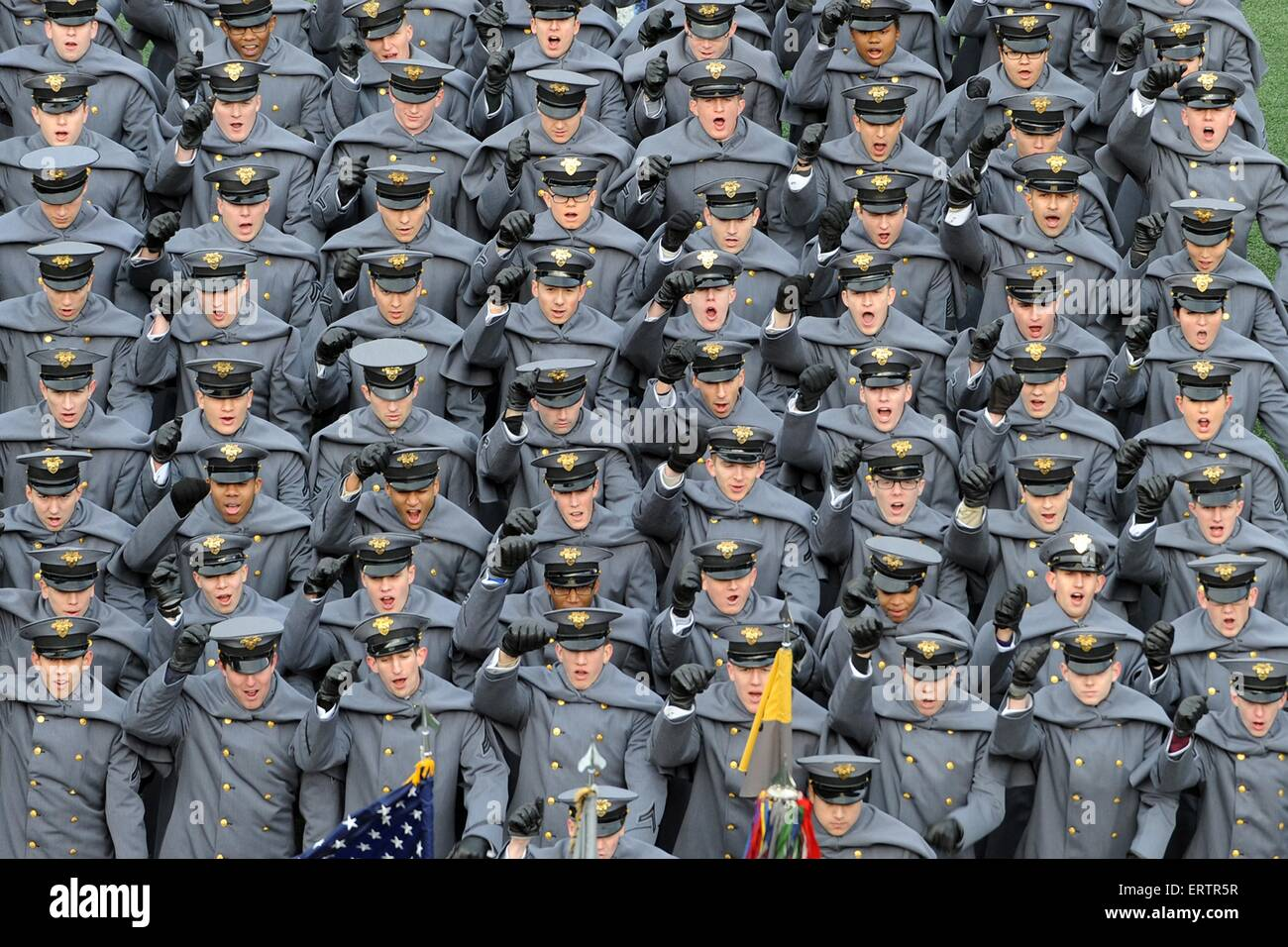 US Army West Point cadets in winter uniform cheer for his team during the 115th Army-Navy football game December - Stock Image
