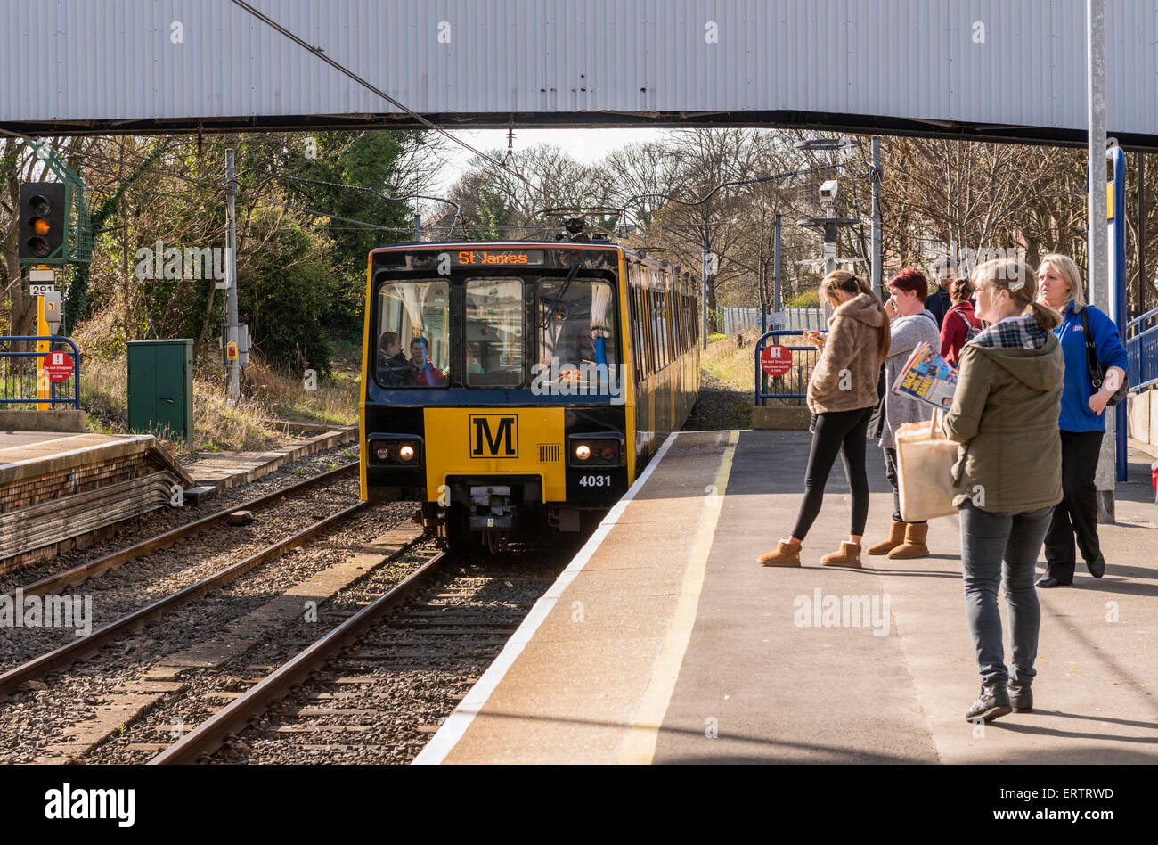 Newcastle Metro train arriving at a station, Newcastle Upon Tyne, North East England, UK - Stock Image
