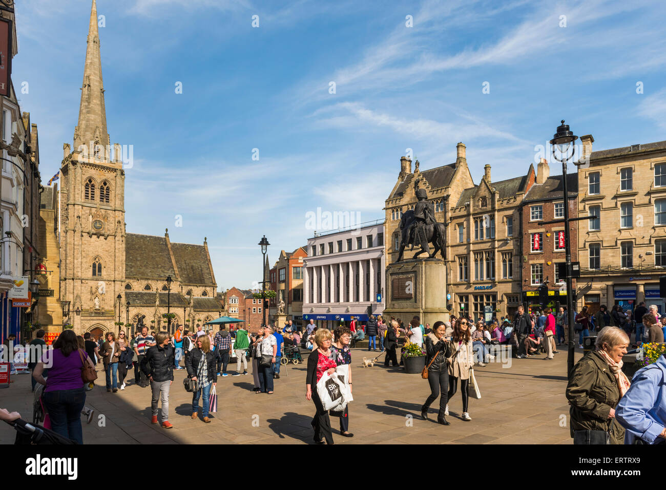 People shopping in the Market Place and church of St Nicholas in Durham, England, UK - Stock Image