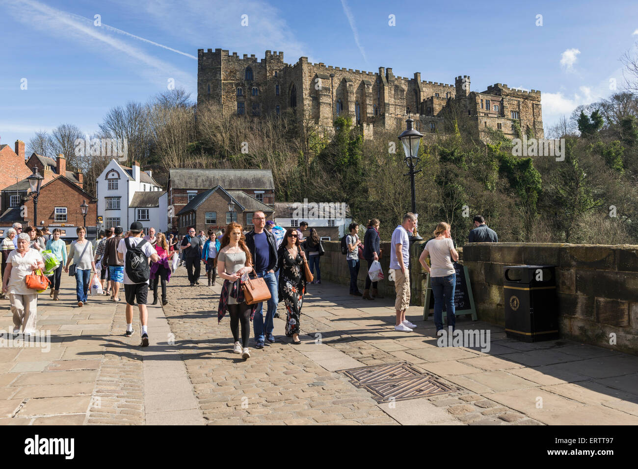 Durham Castle overlooks Framwellgate Bridge on the River Wear, Durham, England, UK with tourists on a sunny day - Stock Image