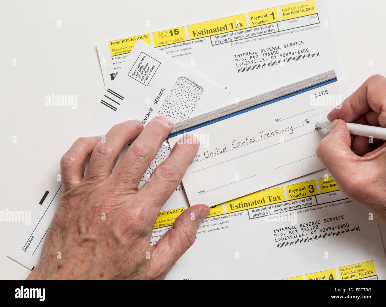Man writing check to internal revenue service irs form 1040 es for man writing check to internal revenue service irs form 1040 es for payment of estimated taxes in 2015 falaconquin