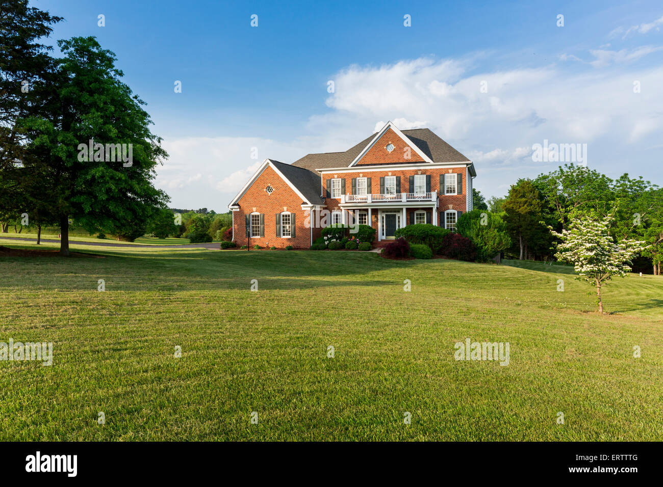 Detached house USA - Front of large single American family home with large garden lawn on a warm sunny summer day Stock Photo