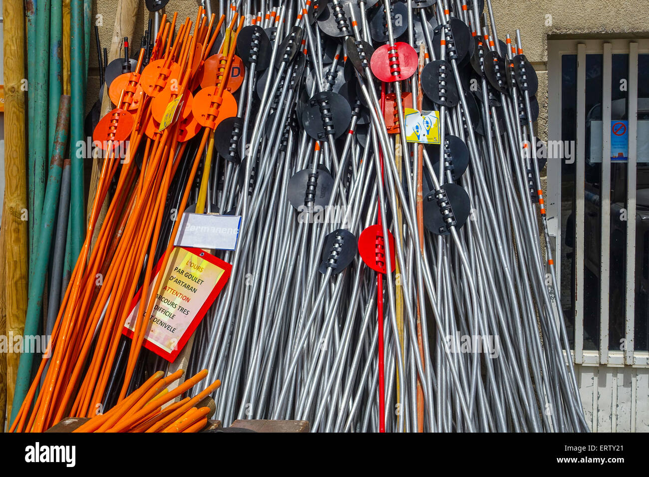 Brightly colored coloured skiing equipment in storage - Stock Image