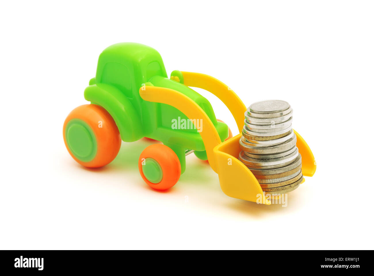 The toy excavator loads money on white background Stock Photo