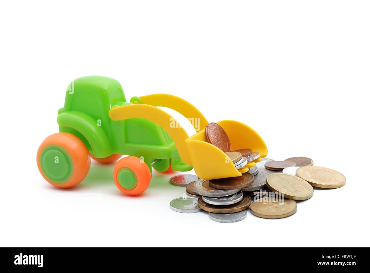 The toy excavator loads money on white background Stock Photo