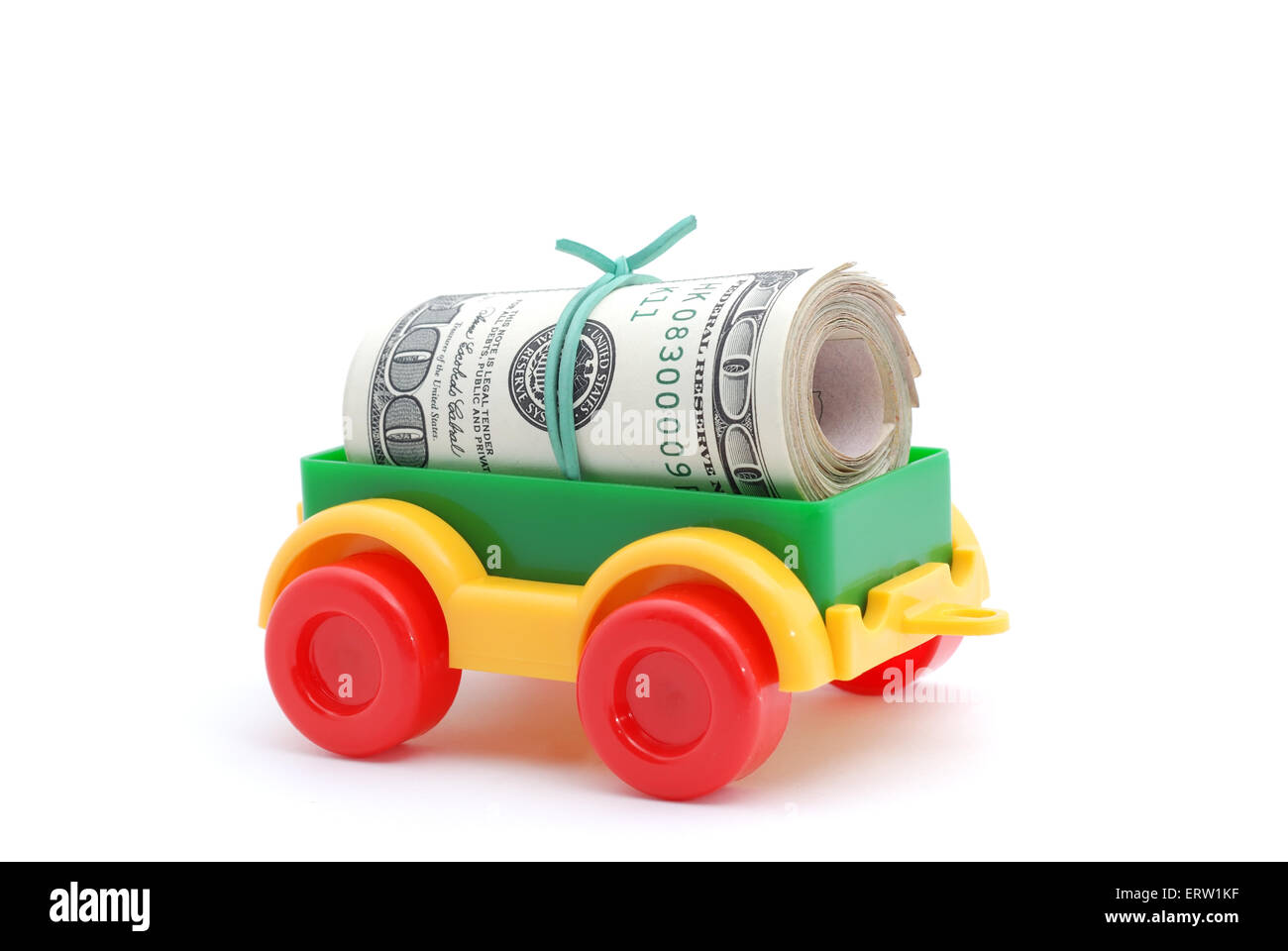 The toy tractor transortation money on white background Stock Photo