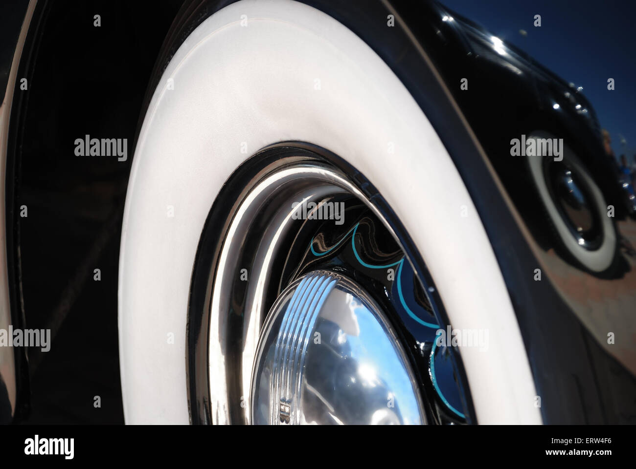 Closeup of the chrome rims with whitewall tire - Stock Image