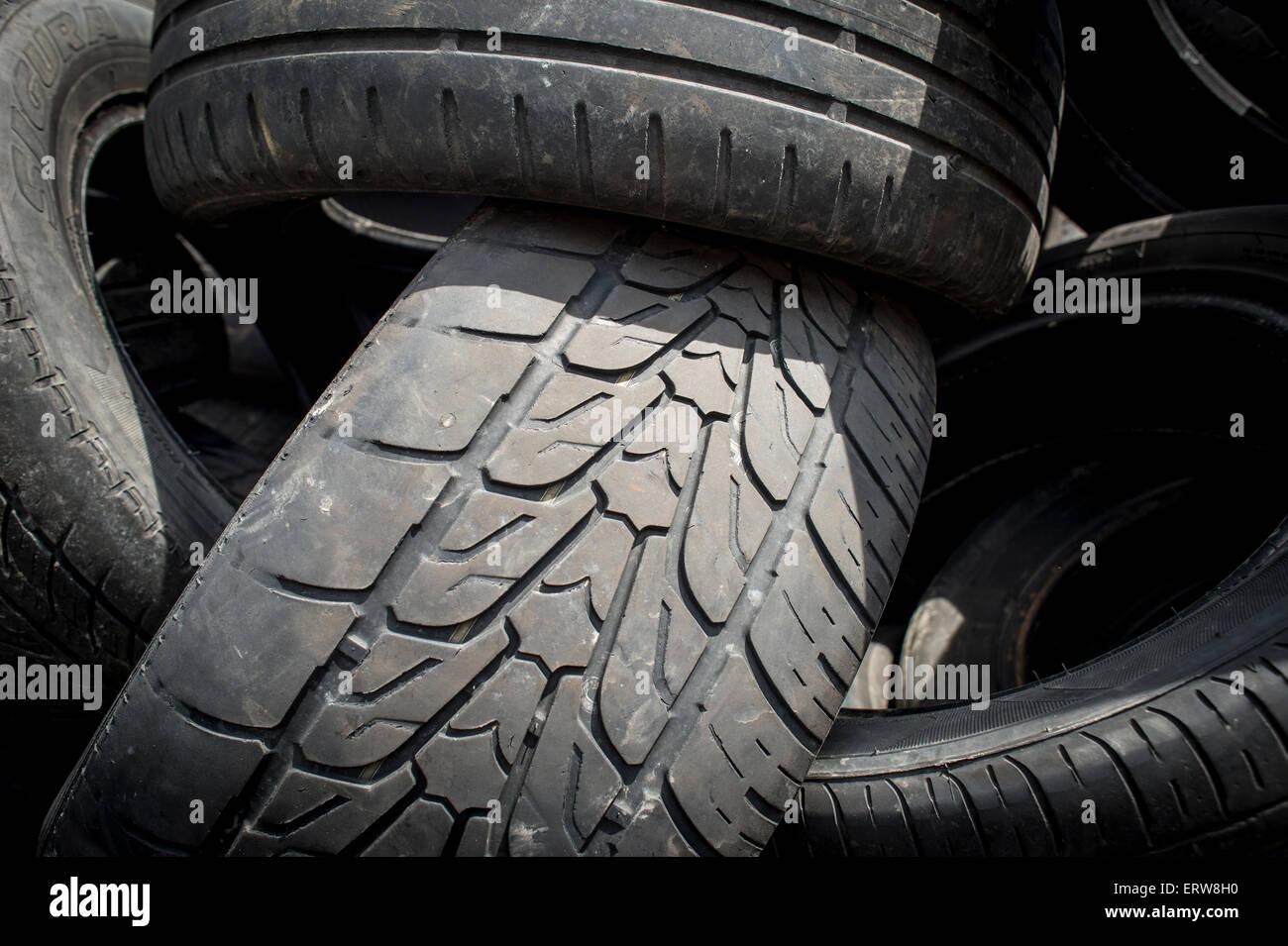 close up of worn car tyres - Stock Image