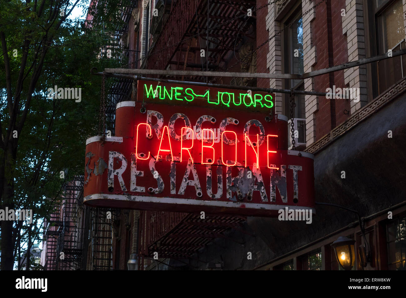 Neon sign outside Carbone, a high-end Italian restaurant in Greenwich Village in New York City - Stock Image