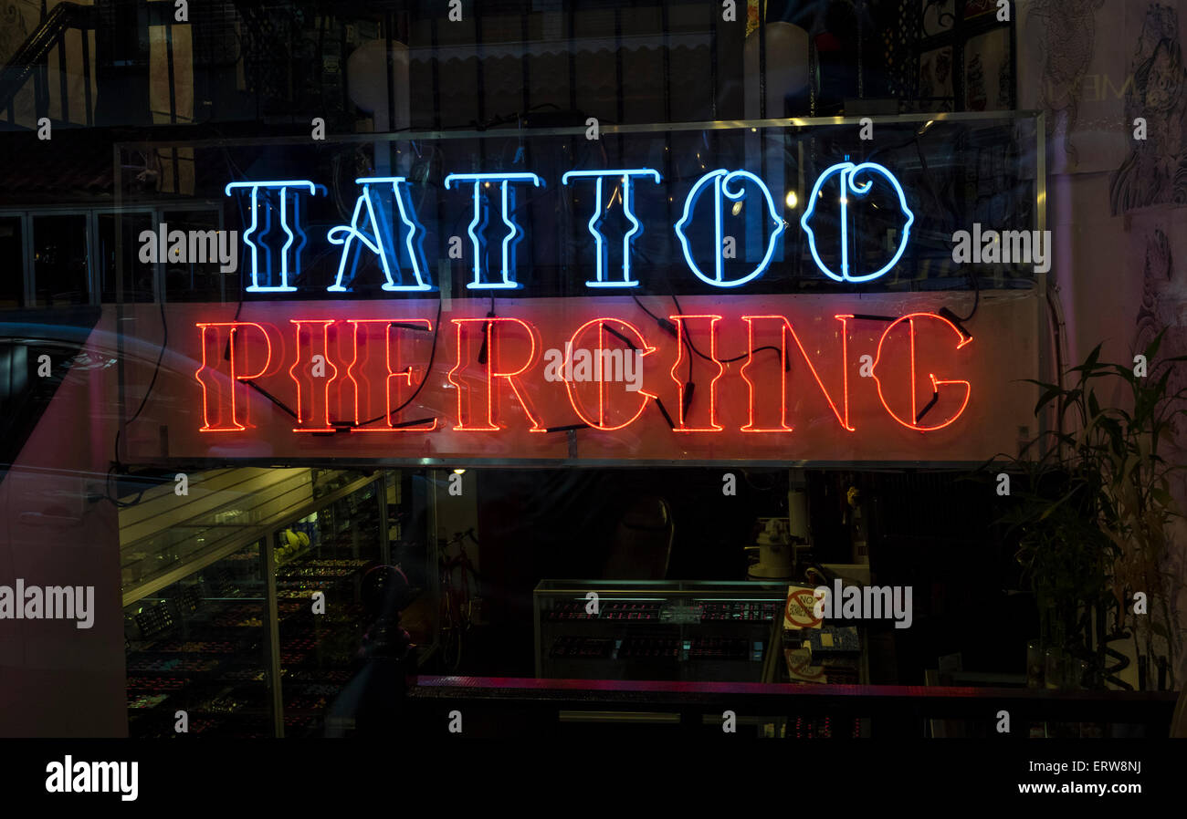 d1c008347 A neon sign in the window of a tattoo and piercing shop in New York City