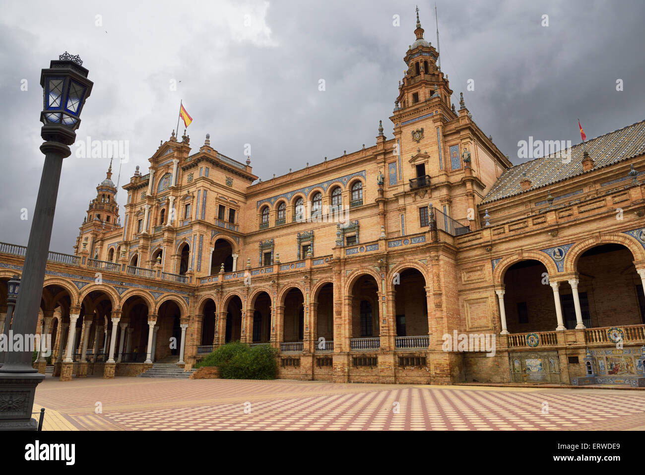 Empty square and dark clouds at the Main Building of Plaza de Espana Seville Spain - Stock Image