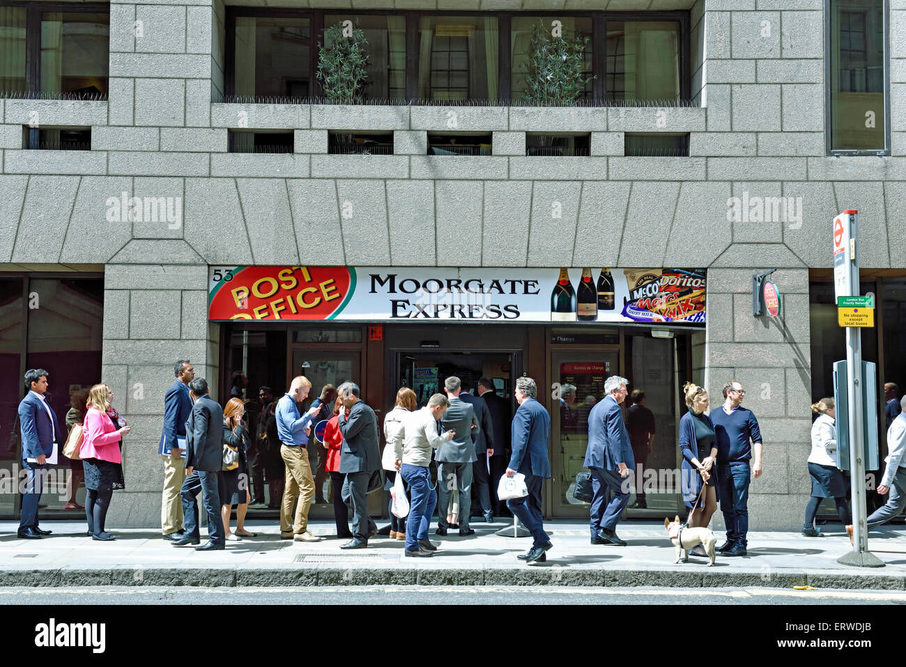Queue outside Moorgate Express Post Office and convienence store, City of London, England Britain UK - Stock Image