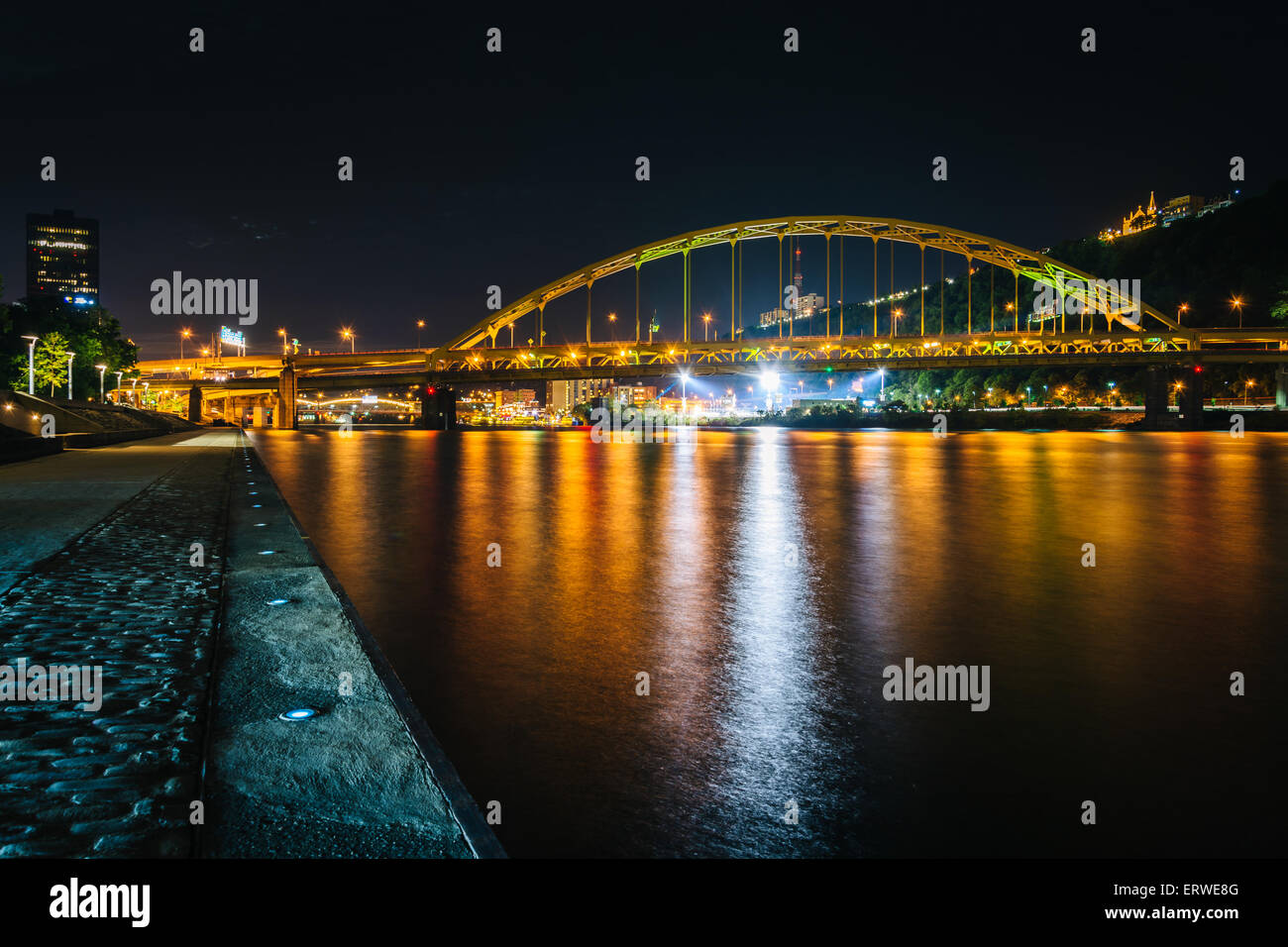 Fort Pitt Bridge at night, seen from Point State Park, in Pittsburgh, Pennsylvania. Stock Photo
