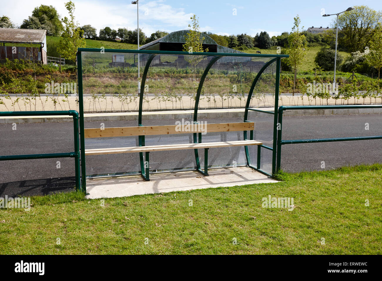 small team dugout benches on a local community sports field county monaghan republic of ireland - Stock Image