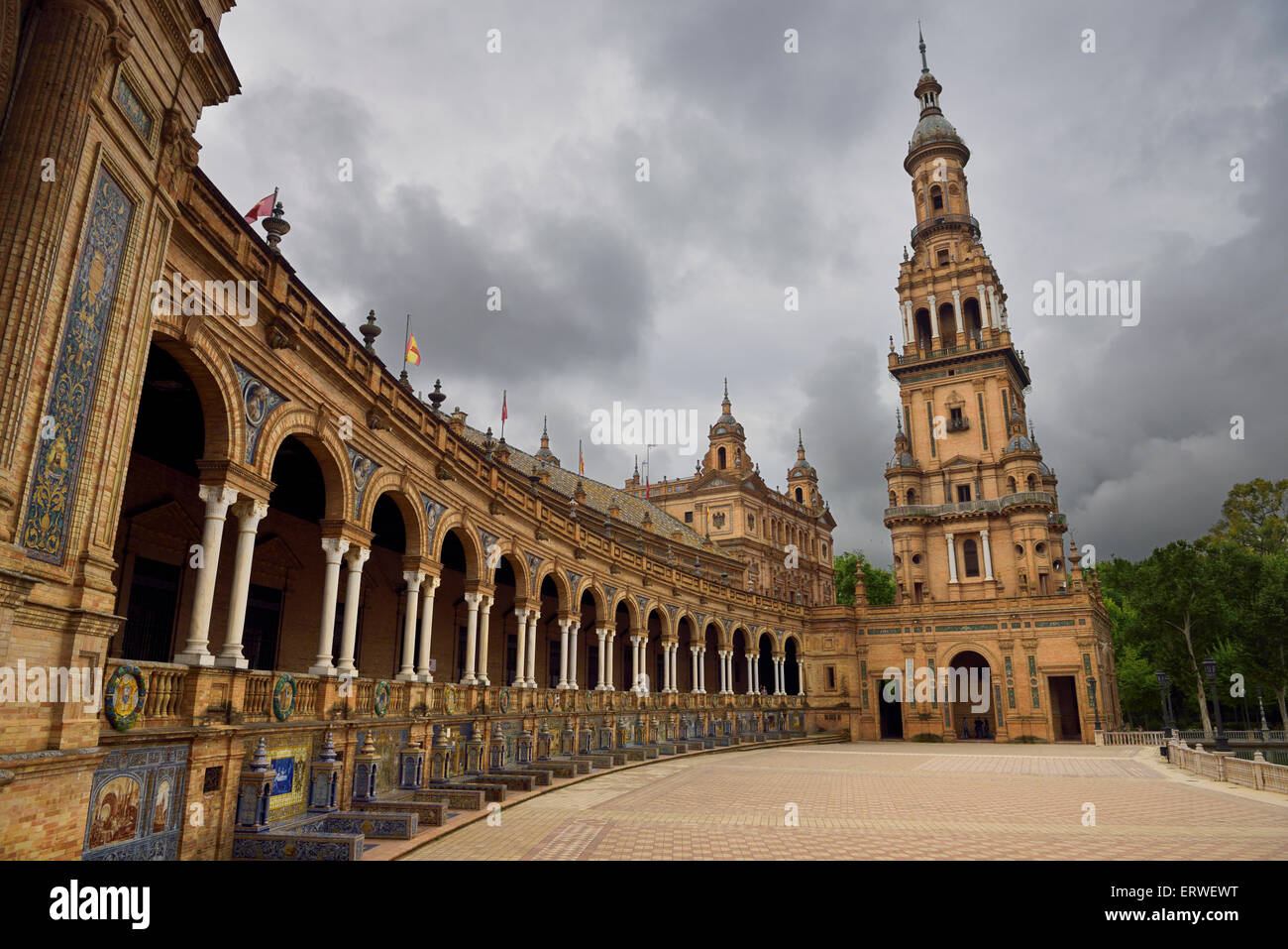 South Tower with curved row of alcoves of Spanish Provinces at Plaza de Espana Seville - Stock Image