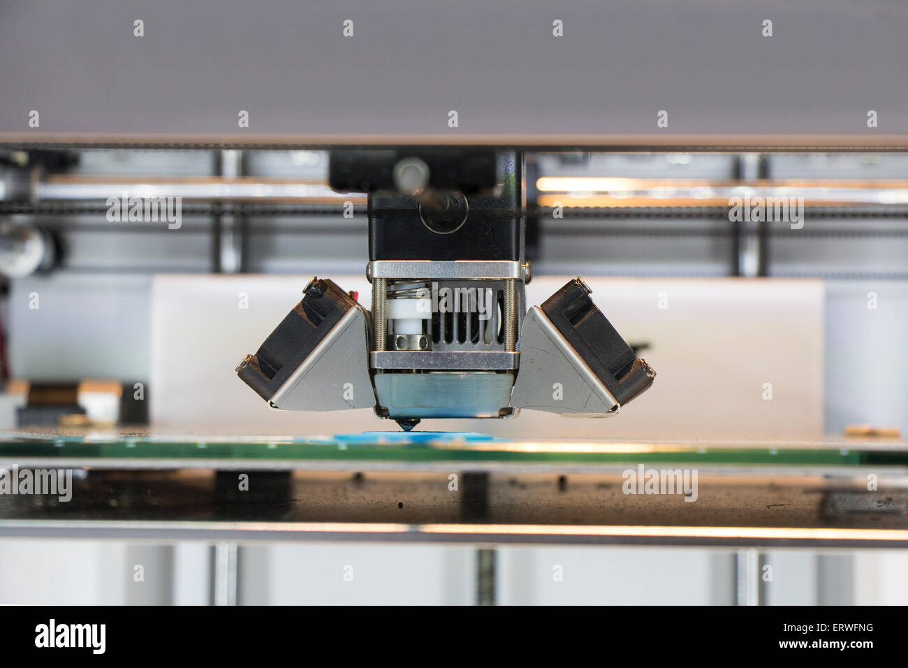 Three dimensional printer, Printing with blue Plastic Wire - Stock Image