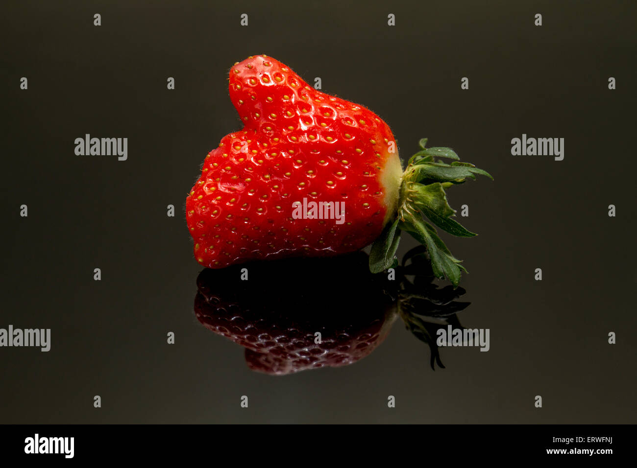 strawberry shaped hand with thumb up Stock Photo