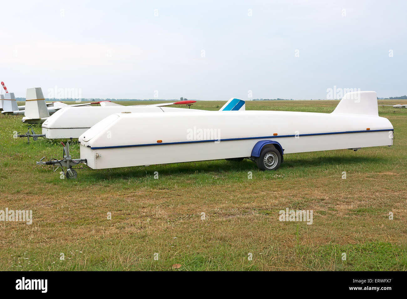 Trailer for transportation glider standing on the airfield. Picture taken on a cloudy day. Overcast. - Stock Image