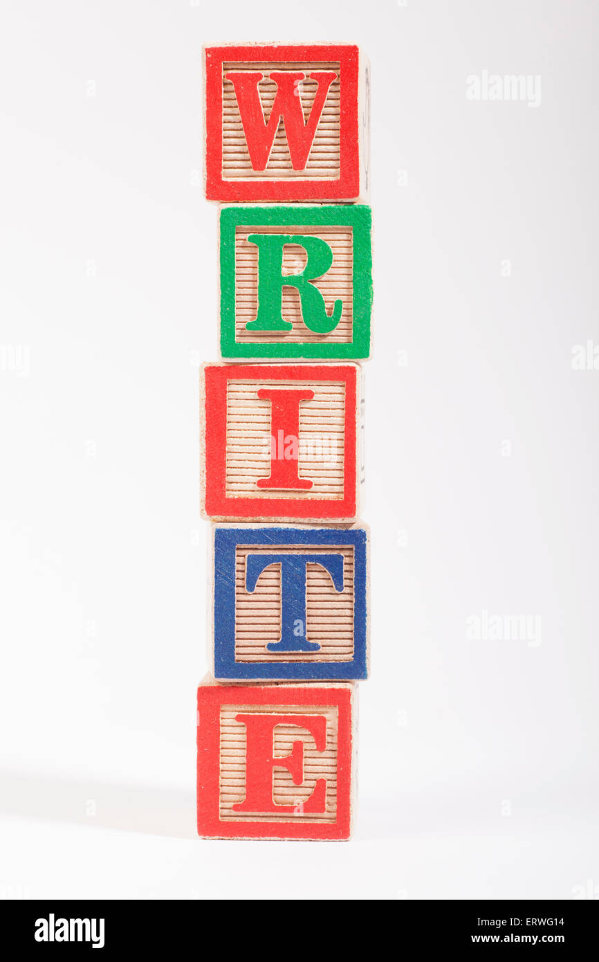 The word 'WRITE' spelt out with Children's building blocks - Stock Image