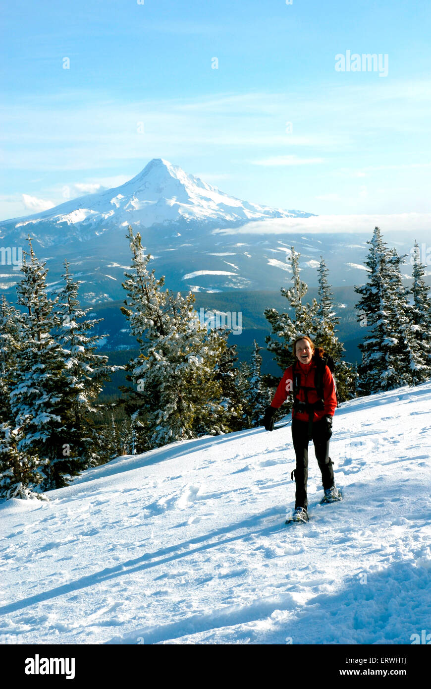 A 45 year old woman hiking Mount Defiant in winter with Mt Hood in the back ground. - Stock Image