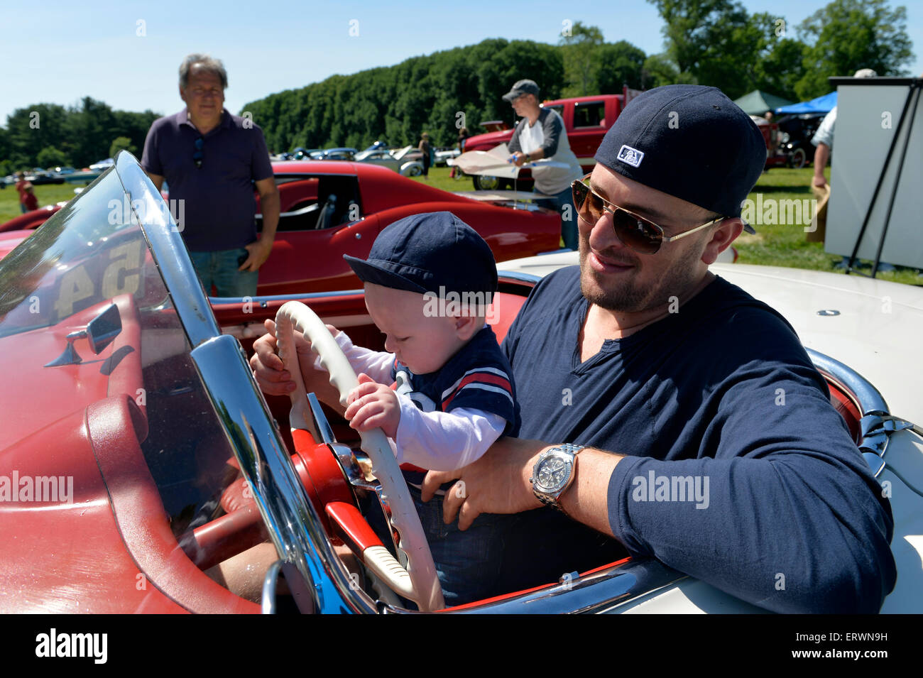 Old Westbury, New York, United States. 7th June 2015. JACKSON STERN, five-months-old, holds the steering wheel of - Stock Image