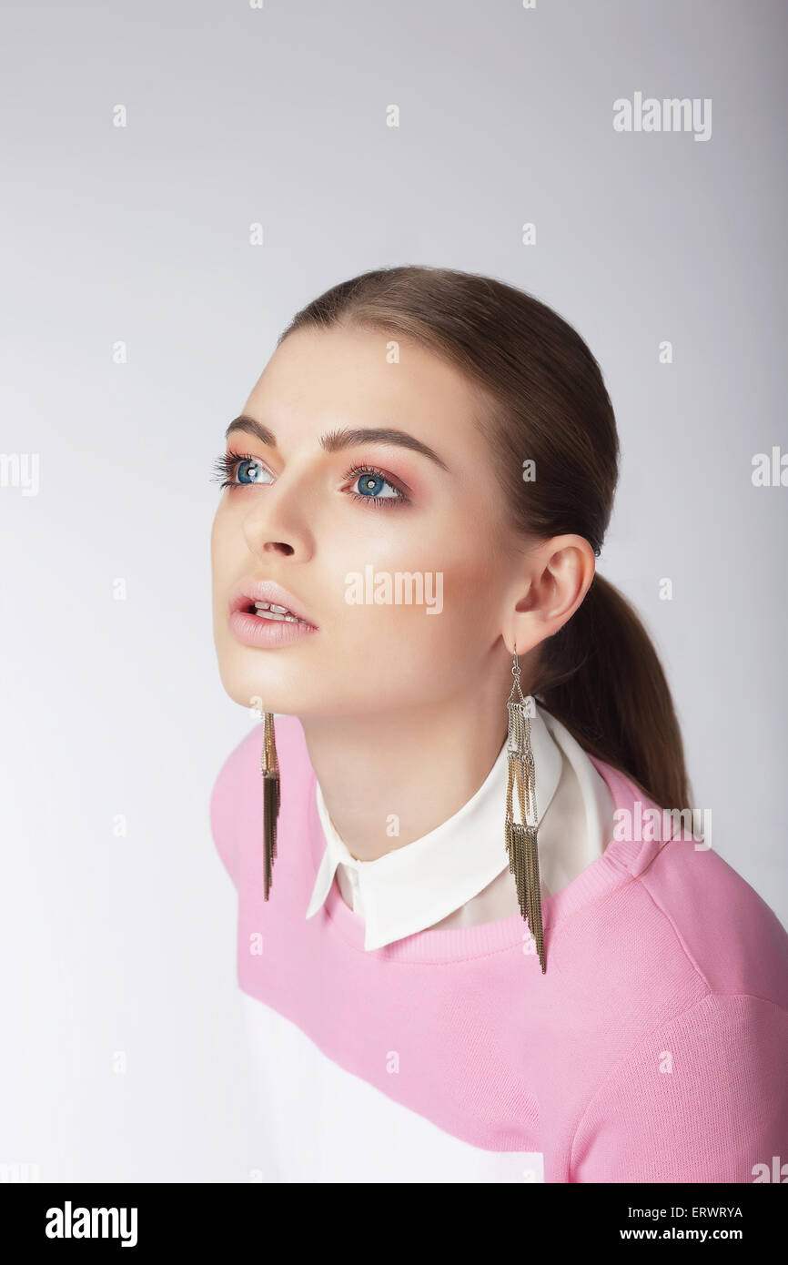 Attractive Young Female Looking Up Stock Photo