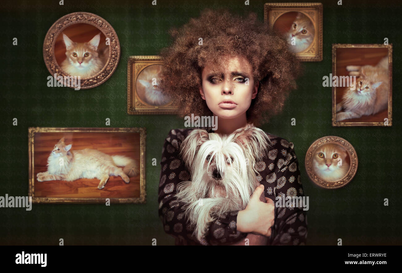 Eccentric Shaggy Woman with Pet - Little Puppy - Stock Image