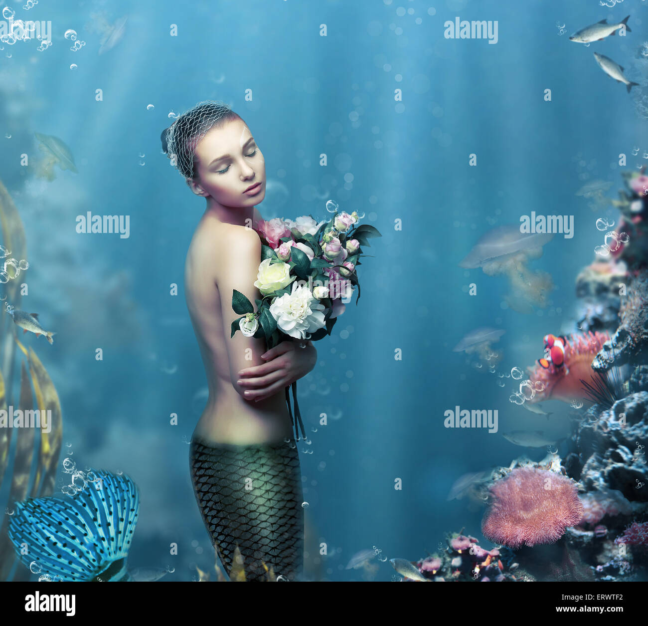 Inspiration. Fantastic Woman with Flowers in Water - Stock Image