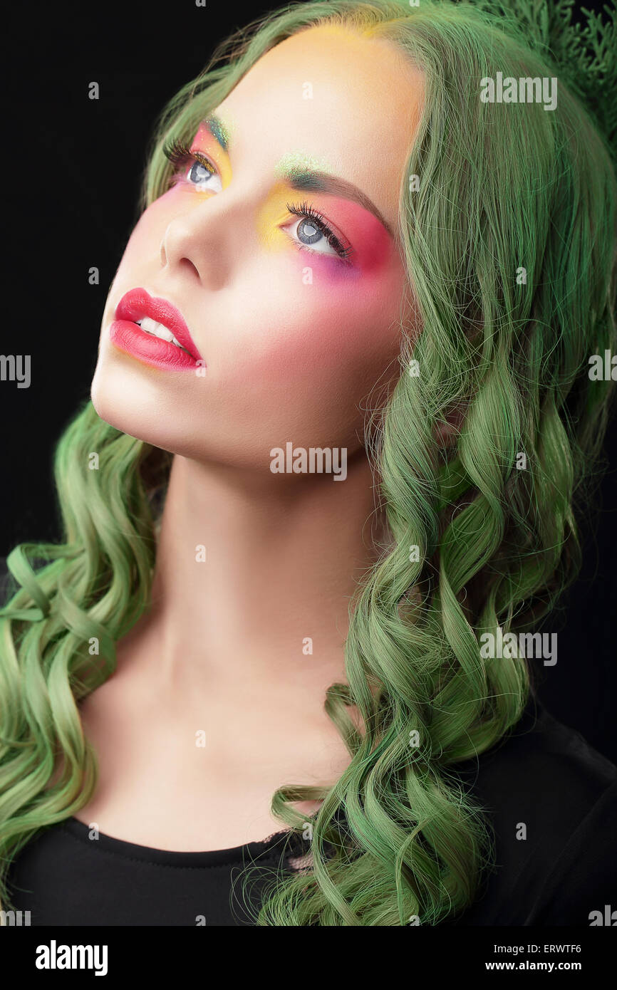 Imagination. Woman with Dyed hair and Fancy Creative Makeup - Stock Image