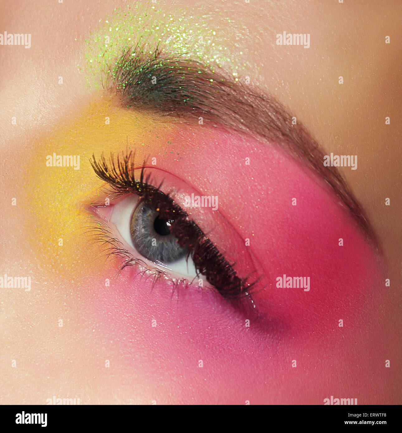 Cosmetics. Mascara. Woman's Eye with Colorful Makeup - Stock Image