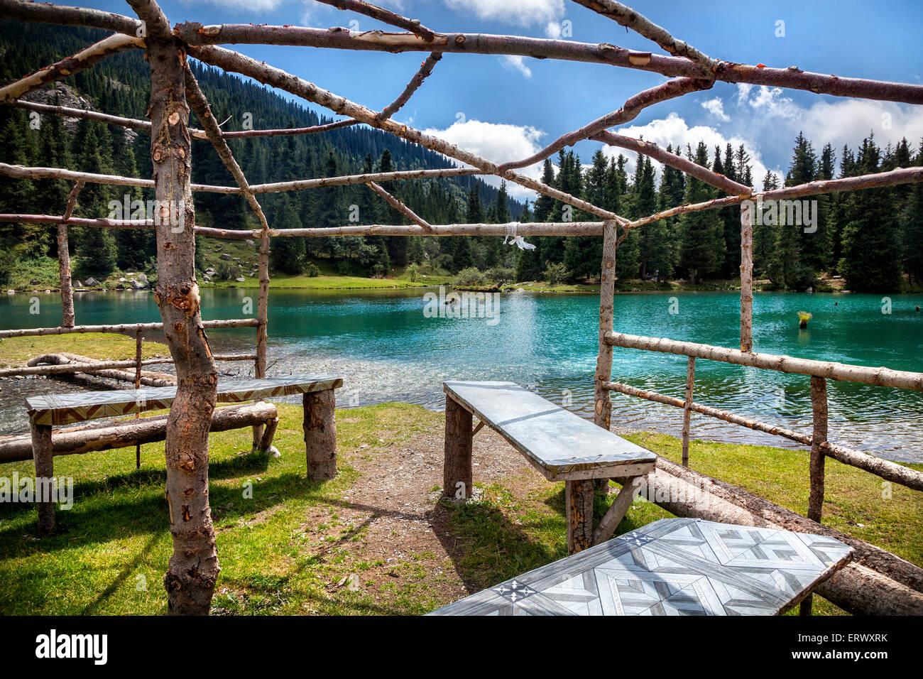 Summerhouse near mountain Saint lake in Gregory gorge of Kyrgyzstan, Central Asia - Stock Image