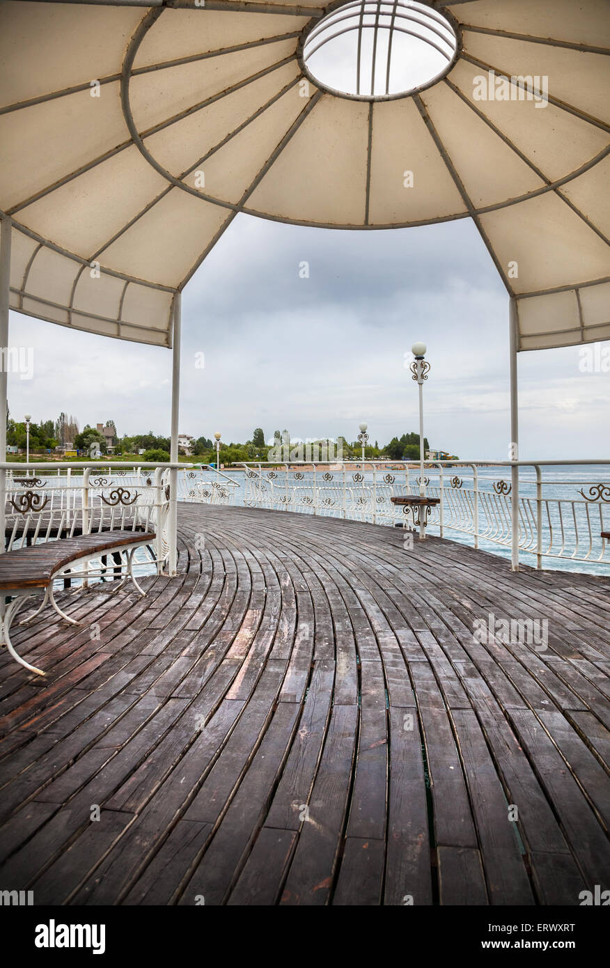 Pier in Ruh Ordo cultural complex near Issyk Kul lake at overcast sky in Cholpon Ata, Kyrgyzstan - Stock Image