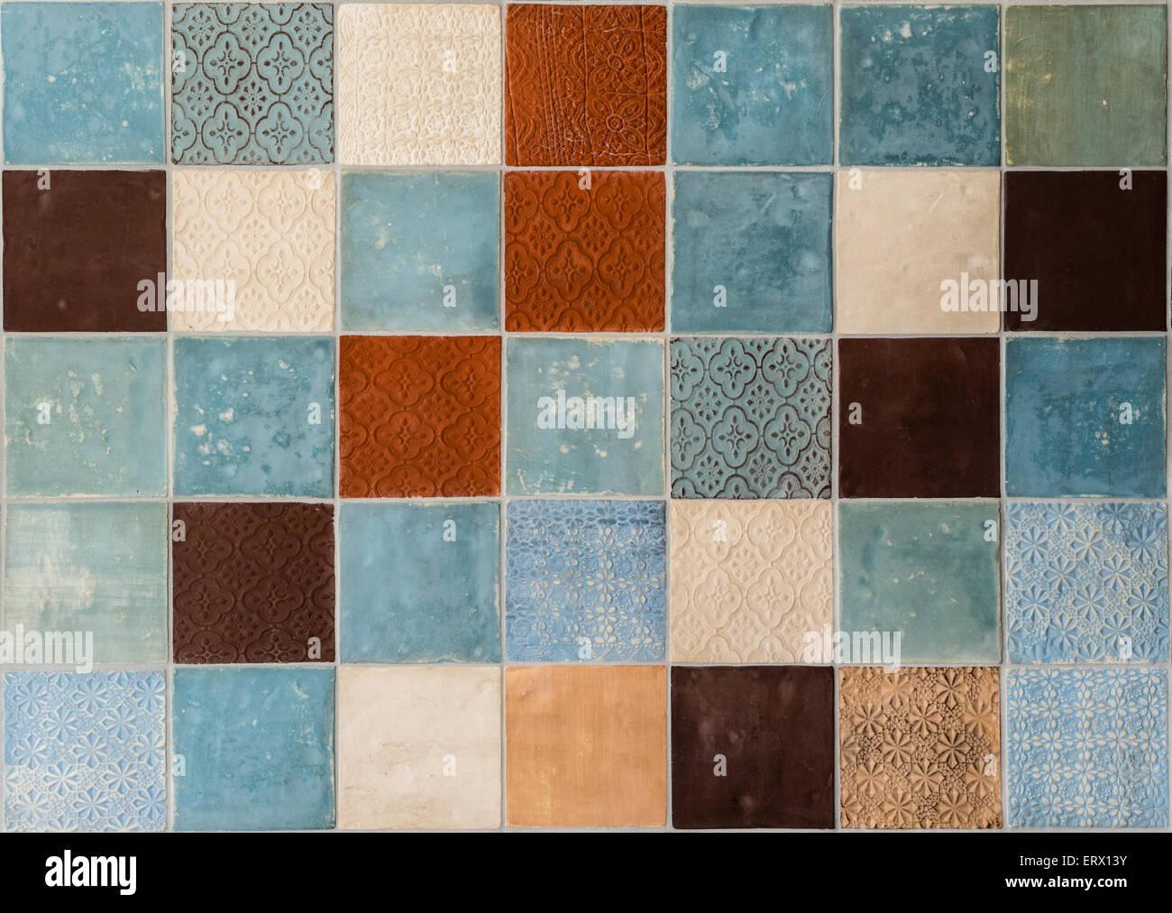 Colorful handmade tiles with rustic patterns - Stock Image