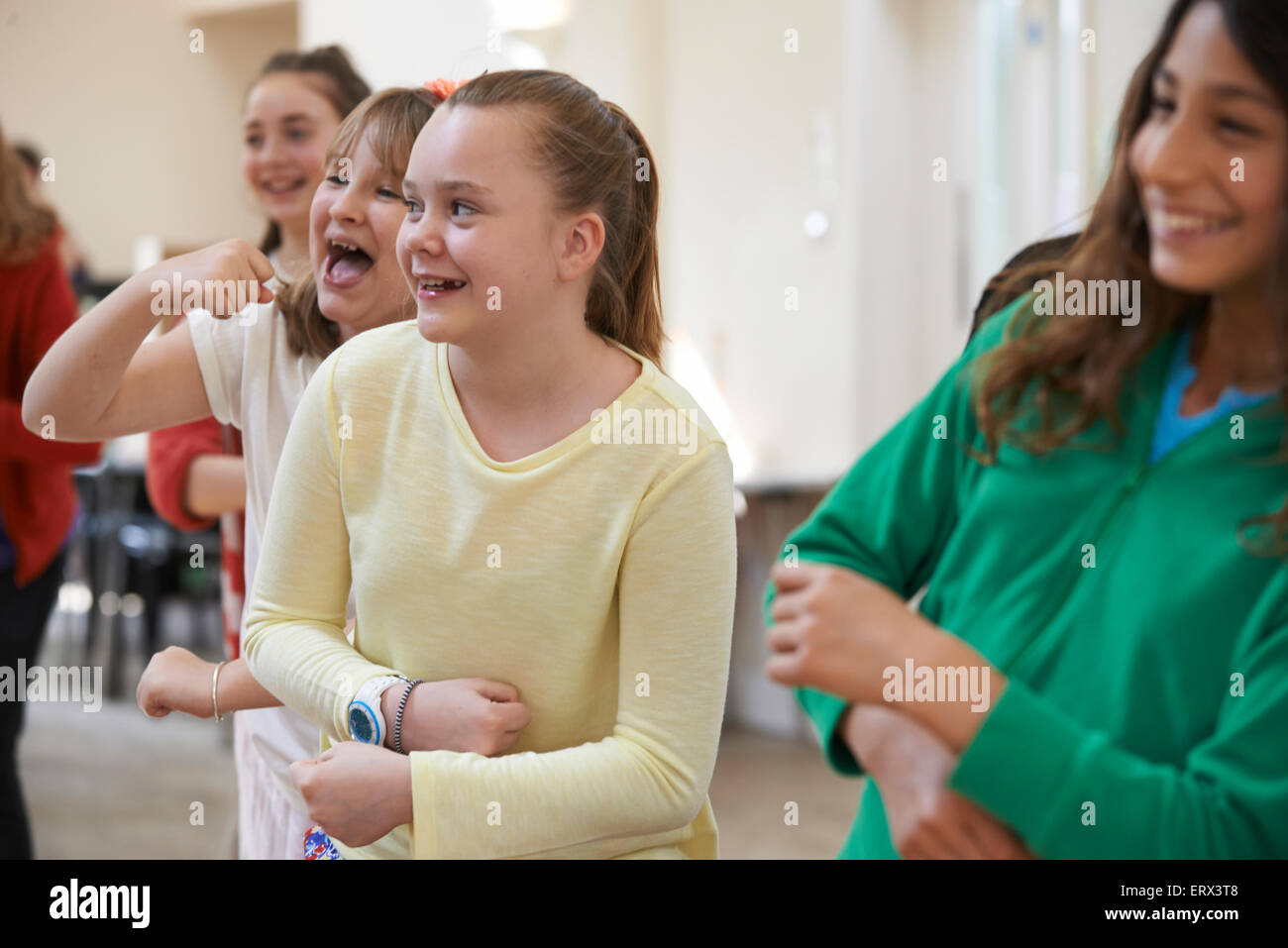 Group Of Children Enjoying Drama Class Together - Stock Image