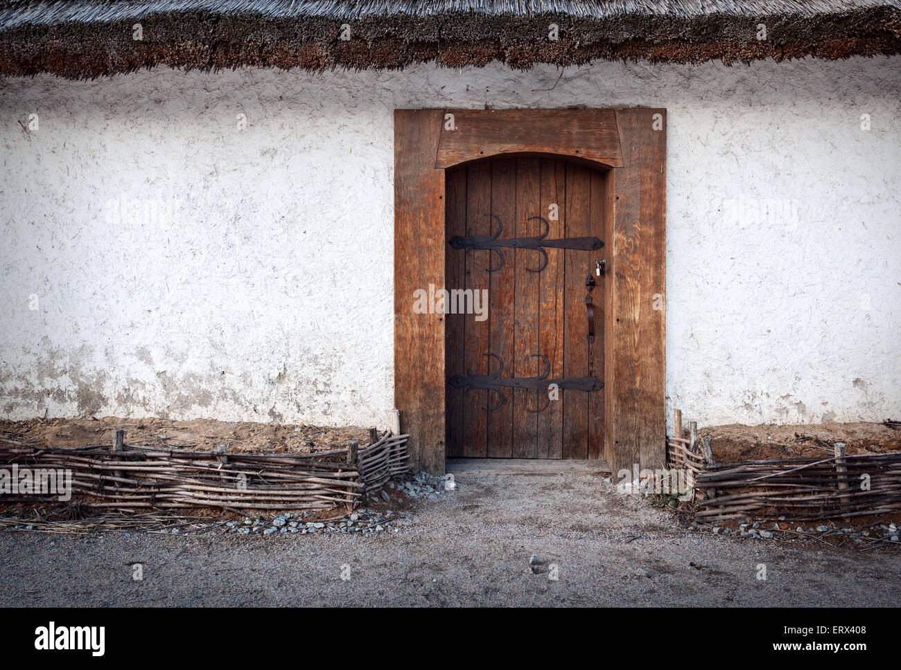 Wooden Old Door With Lock And Clay Wall. Background For Design
