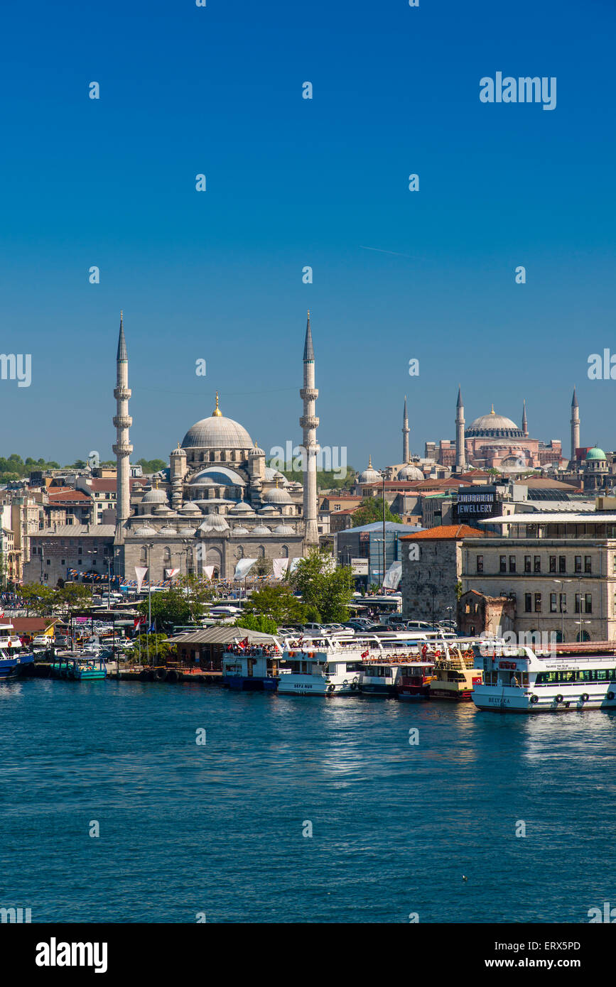 City skyline with Yeni Cami or New Mosque and Hagia Sophia, Istanbul, Turkey - Stock Image