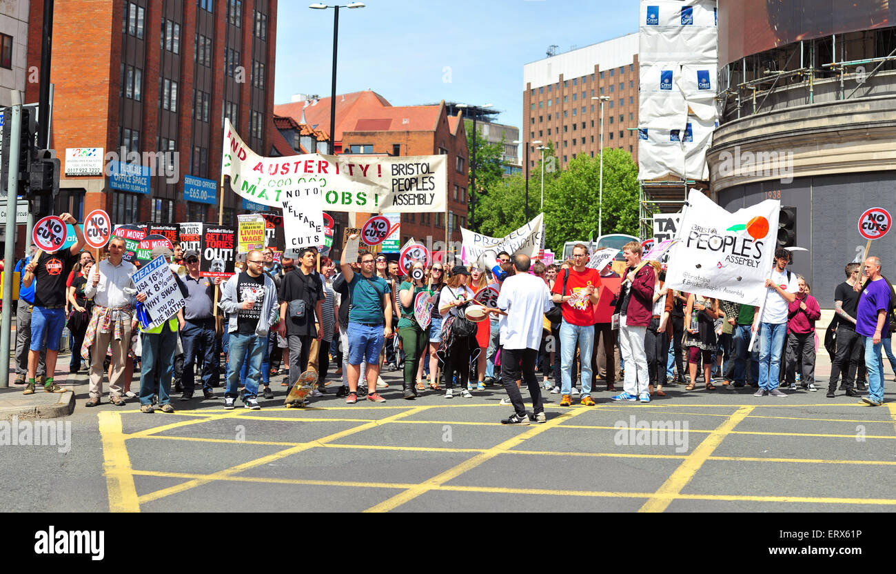An anti-austerity protest marches through the streets of Bristol. - Stock Image