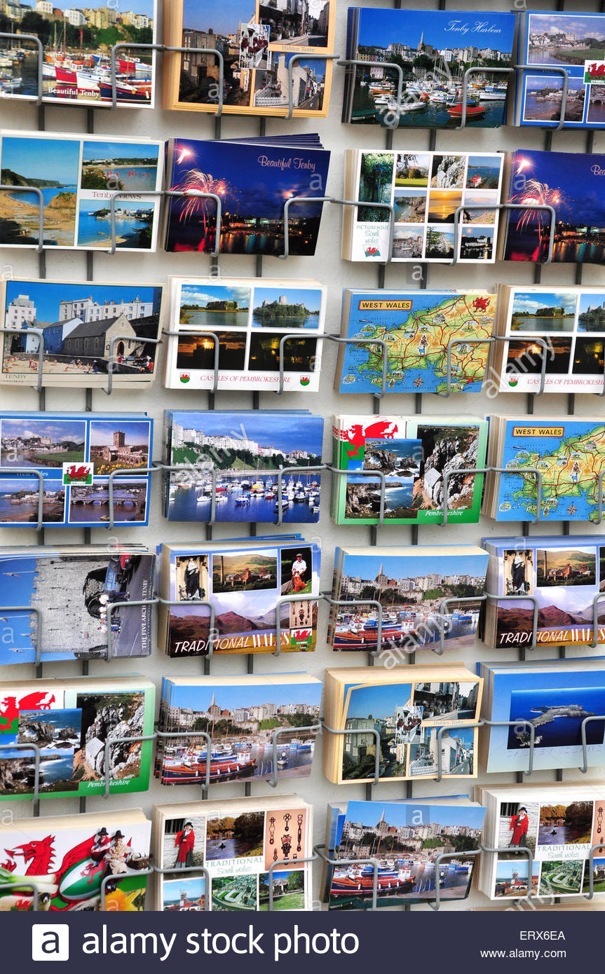 A rack of postcards for sale outside a shop in Tenby, Pembrokeshire. - Stock Image