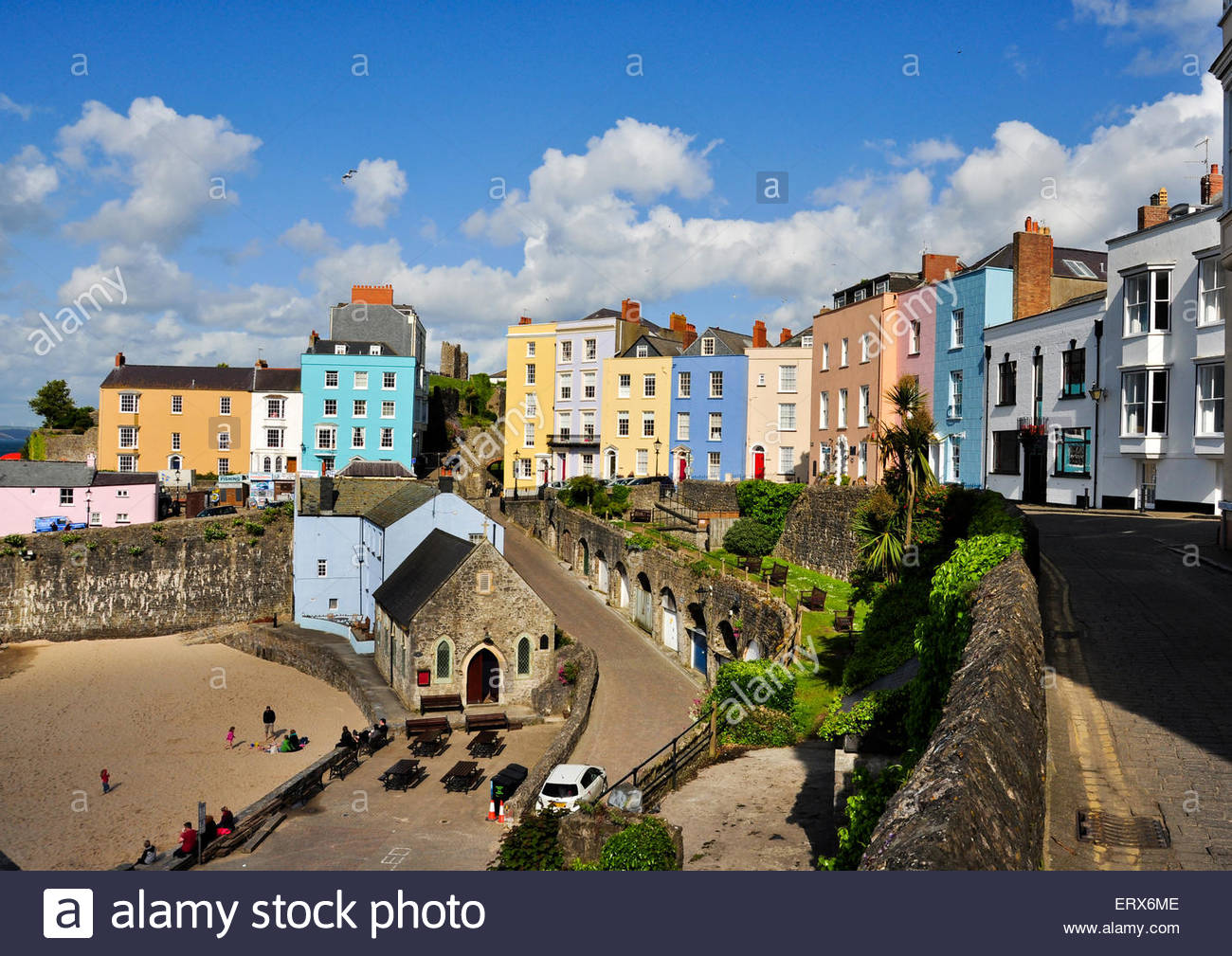 Colourful buildings surround the harbour at Tenby, Pembrokeshire in Wales, UK - Stock Image