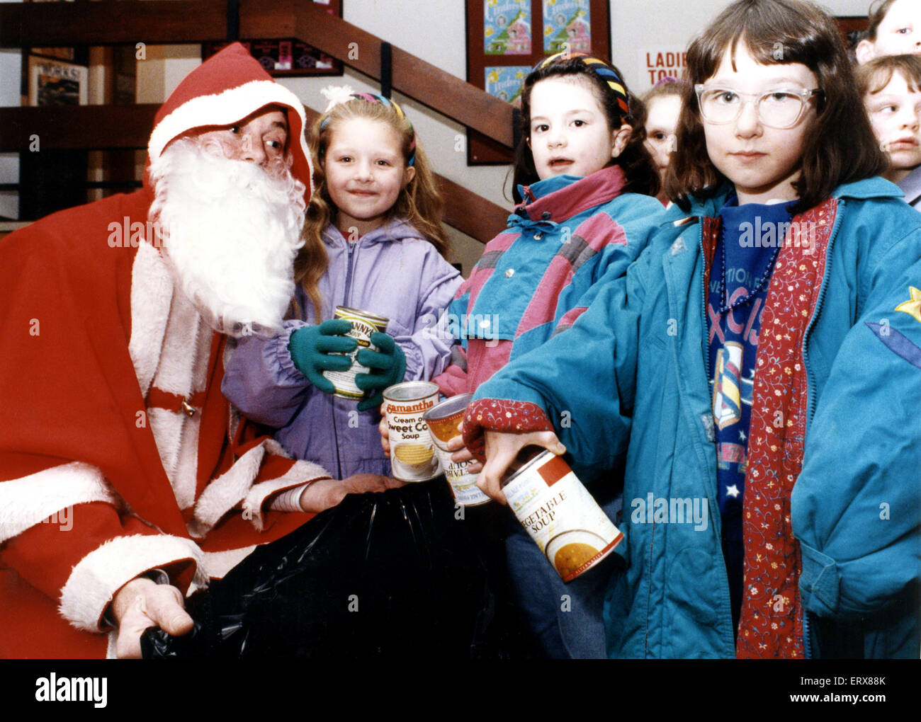 Children turned the tables on Santa at the Billingham Forum - taking gifts to him. 500 lucky youngsters and their - Stock Image