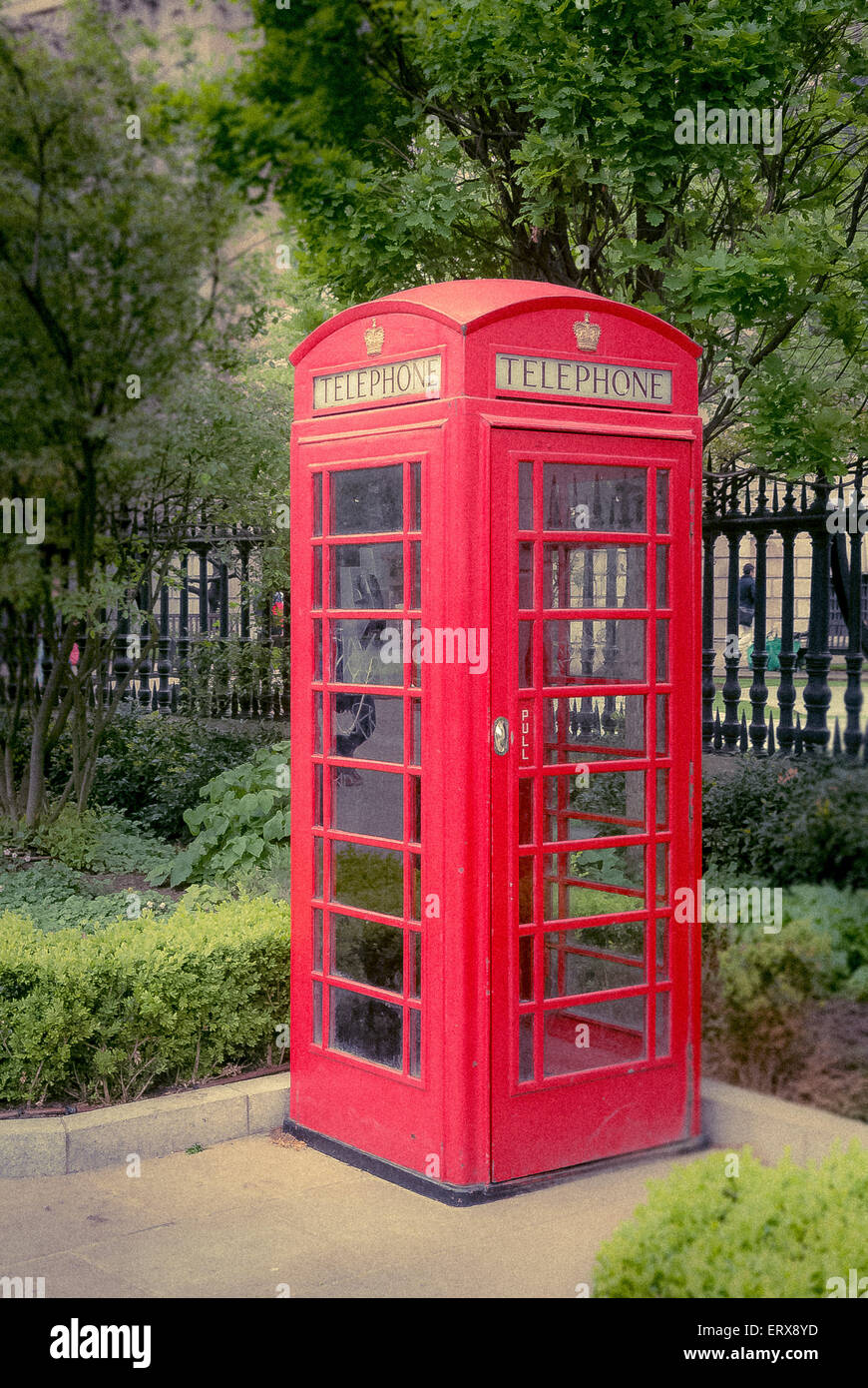 Traditional red telephone box, UK. - Stock Image