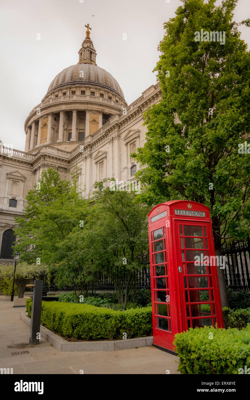 Traditional red telephone box outside St Paul's Cathedral, London, UK. - Stock Image